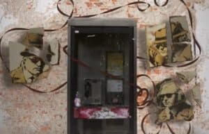 Banksy's 'Spy Booth' Brick and NFT Auction Rescheduled After Overwhelming Traffic Crashes Servers