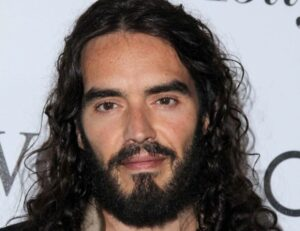 Russell Brand Receives Backlash For Video On Indictment Of Clinton Lawyer